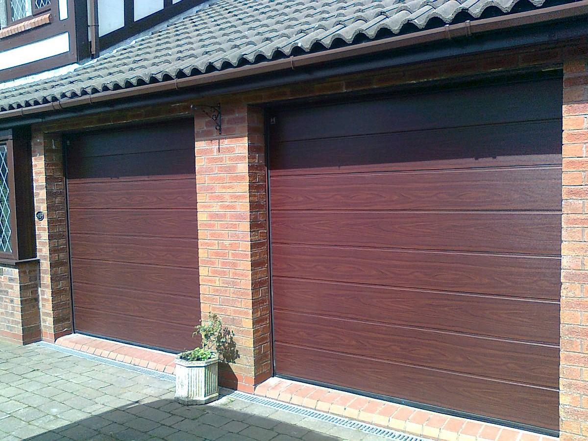 Cbl are proud suppliers of garage door customers in the north west recentangle patterned garage doors rubansaba