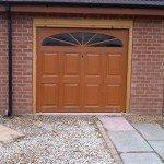 Brown garage doors with window